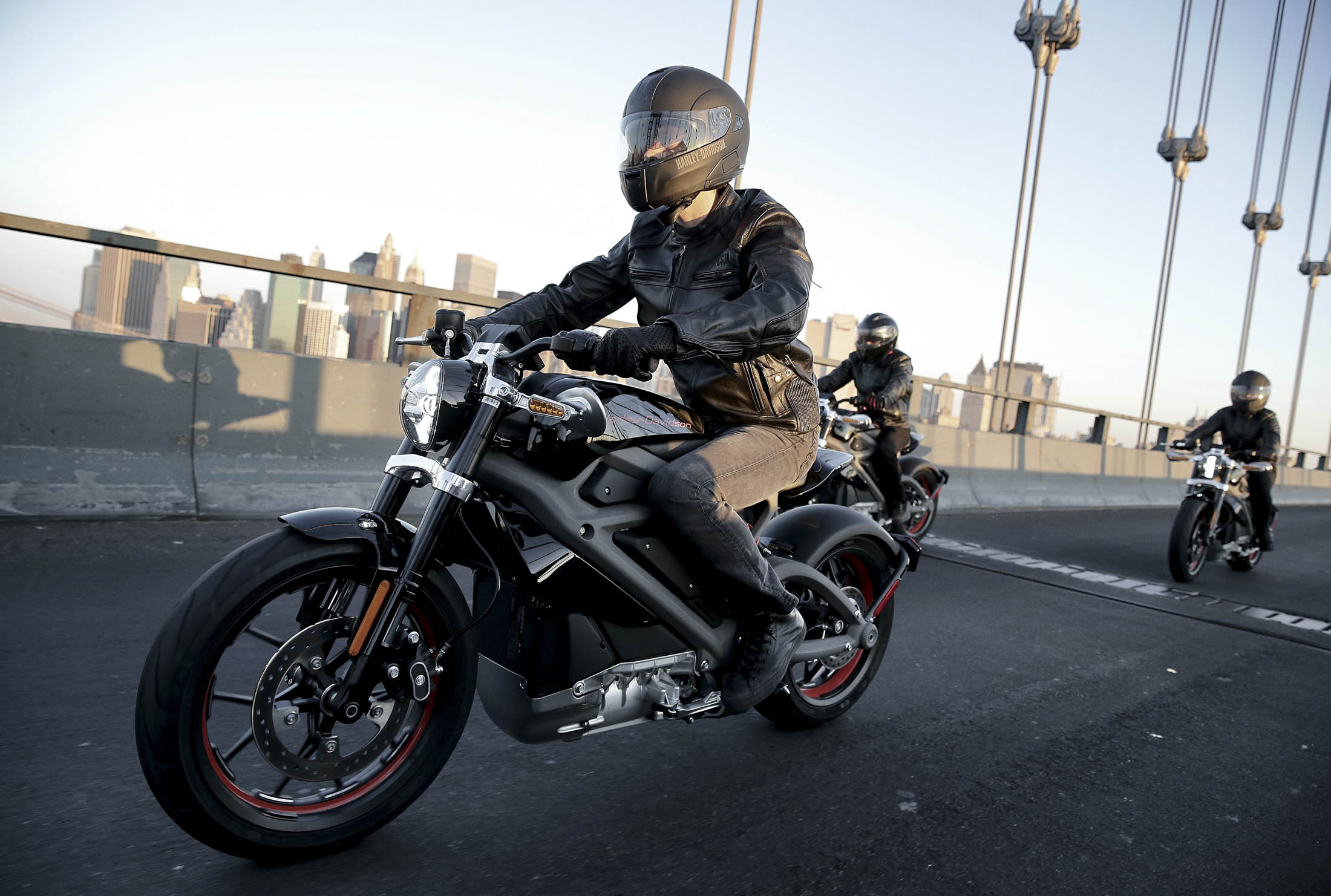 NEW YORK, NY - JUNE 23:  Harley-Davidson riders reveal Project LiveWire, the first electric Harley-Davidson motorcycle during a special ride across the iconic Manhattan Bridge on June 23, 2014 in New York City.  (Photo by Neilson Barnard/Getty Images for Harley Davidson)