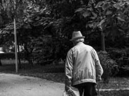 grayscale-back-view-photo-of-elderly-man-with-cane-walking-2586537