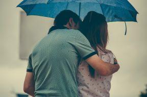 man-hugging-woman-while-holding-umbrella-1534633