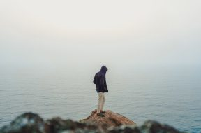 man-standing-on-sea-cliff-3464179